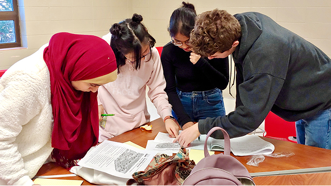 [Photo of Students Around the Table]ASMS Students Succeed in National Mathematics Puzzle Competition