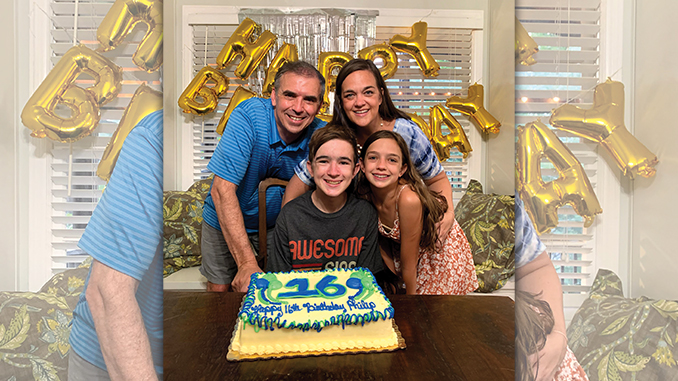 Phillip Moss and his family celebrate his sixteenth birthday.